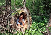 Man in a hollow trunk