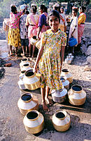 Girl filling water , India