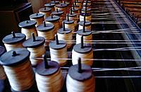 Bobbins at mechanized loom. Pawtucket. Rhode Island. USA