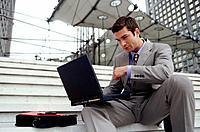 Executive with laptop computer