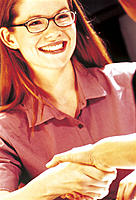 Young Businesswoman in Glasses Shaking Hands