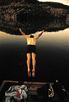 Rearview, Man Diving into Lake Off of Dock