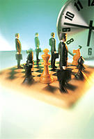 Chess Board and Clock with Business Figurines