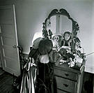 Two Young Girls Playing Dress-up in Front of the Mirror, B&W