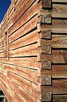 Detail of wall joint of log home under construction. Colorado. USA