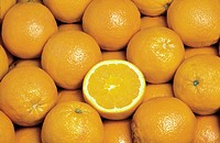 Pile of Oranges with One Cut in Half