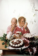 Two girls eating redcurrant desserts