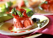 Strawberry mousse, with fresh strawberries on a skewer