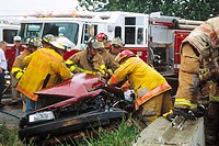 Rescue personnel work to free trapped driver