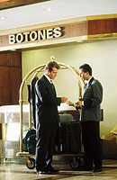 Businessman with bellboy in a hotel