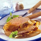 Two slices of roast lamb with honey and almonds
