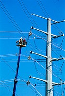 Workers installing power lines