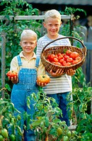 Two brothers and their homegrown tomatoes