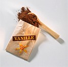 Powdered vanilla from a packet with label, vanilla & spoon