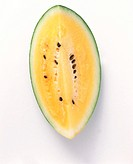 A slice of pineapple melon (yellow watermelon)