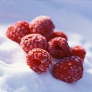 Frozen raspberries on crystal sugar