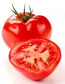 Whole and half tomato