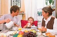 FAMILY EATING BREAKFAST<BR>Models.