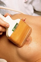 BREAST, ULTRASOUND EXAMINATION<BR>Photo essay from hospital with model and doctor.