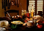 Table spread with various foods and cooking ingredients