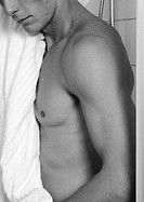 Man drying off with towel, close-up, side view, b&w