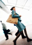 Business people walking, low angle view, blurred