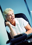 Businesswoman raising fist and smiling