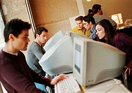 People using computers, side view