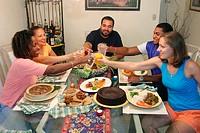 Jamaican immigrants eating Jamaican foods. Kendall. Florida. USA