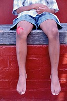 Boy with injured knee