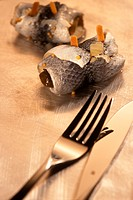 Two rollmops and cutlery