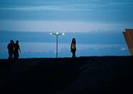 Friends walking at sunset