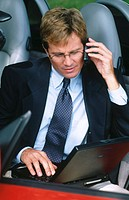 businessman in car on cellular