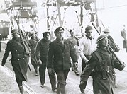 Soldiers marching on a road