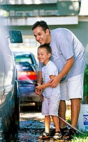 father and son washing a car