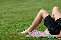 Young man relaxing on a meadow, lake Chiemsee. Seebruck. Chiemgau. Bavaria. Germany