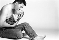 Asian man holding baby