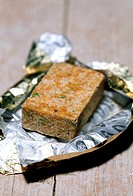A vegetable stock cube in foil