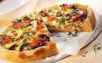 Mushroom tart with spring onions and ham