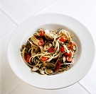 Spaghetti with mussels, cherry tomatoes and chili pepper