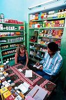 MEDICINE IN INDIA<BR>Photo essay.<BR>Rajasthan / Pushkar. Ayurvedic medicine. Consultation and writing the prescription.