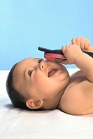 INFANT PLAYING INDOORS<BR>Model.<BR>8-month-old baby.