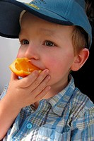 CHILD EATING FRUIT<BR>Model.<BR>3 and a half year-old child.