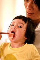 CHILD EATING A MEAL<BR>Models.
