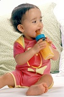 INFANT DRINKING FROM BABY BOTTLE<BR>Model.<BR>1-year-old girl.