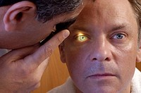 OPHTHALMOLOGY, MAN<BR>Photo essay. Model and doctor.<BR>Ophthalmology exam: checking the retina, blood vessels, macula, optic nerve. Screening necessa...