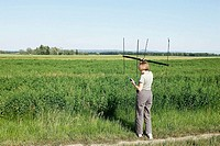 Naturalist working with sound sensor in field. Alsace, France