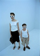 A woman and a boy wearing virtual reality glasses