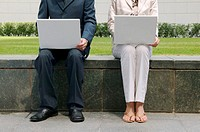 Businesspeople using laptop computers