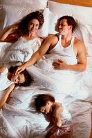 High angle view of a couple in bed with their son and daughter
